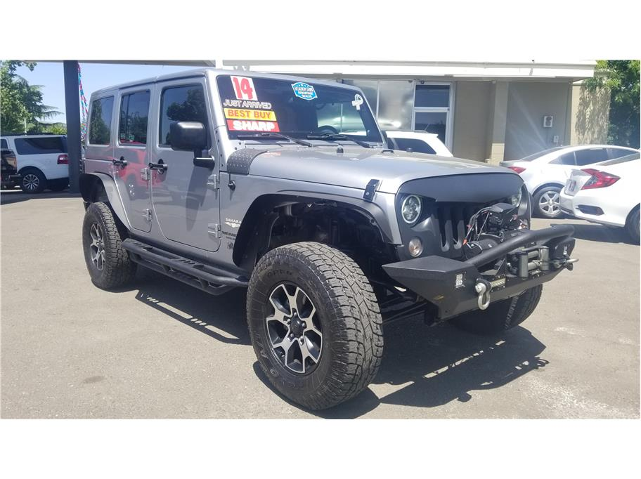 Used 2014 Jeep Wrangler Unlimited Sahara Sport Utility 4D in Madera, CA