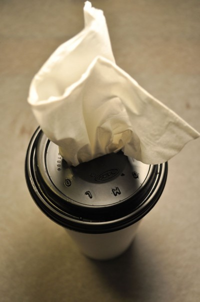 Use a coffee cup to store tissues and get rid of that stereotype cardboard-box