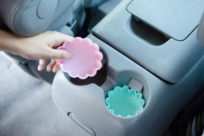Place silicone muffin cups at the bottom of each cup holders to keep the dirt and grime free