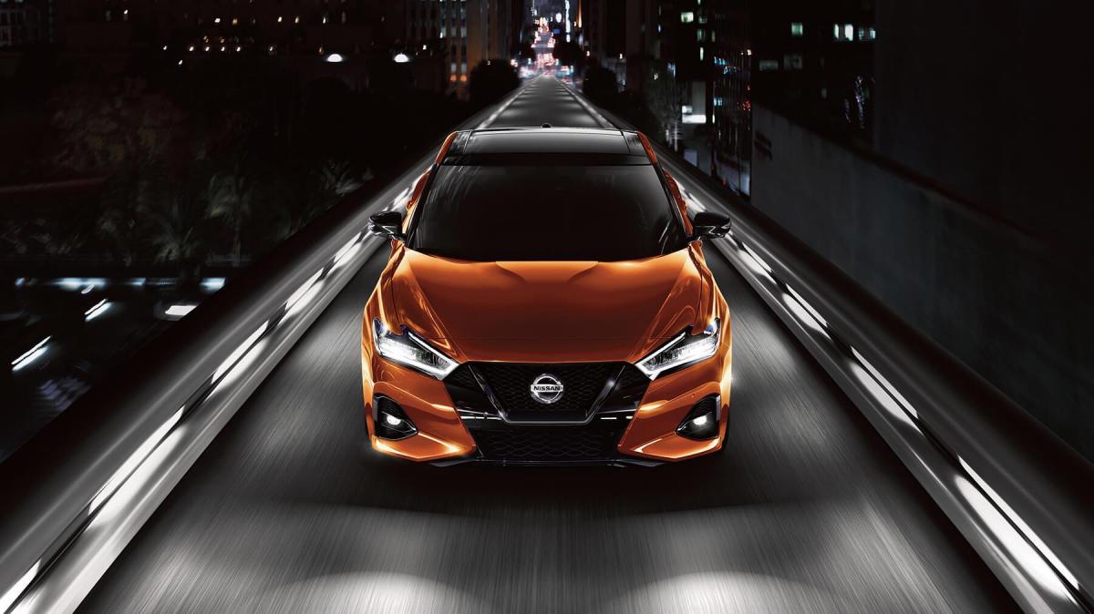 Nissan Maxima Driving on bridge