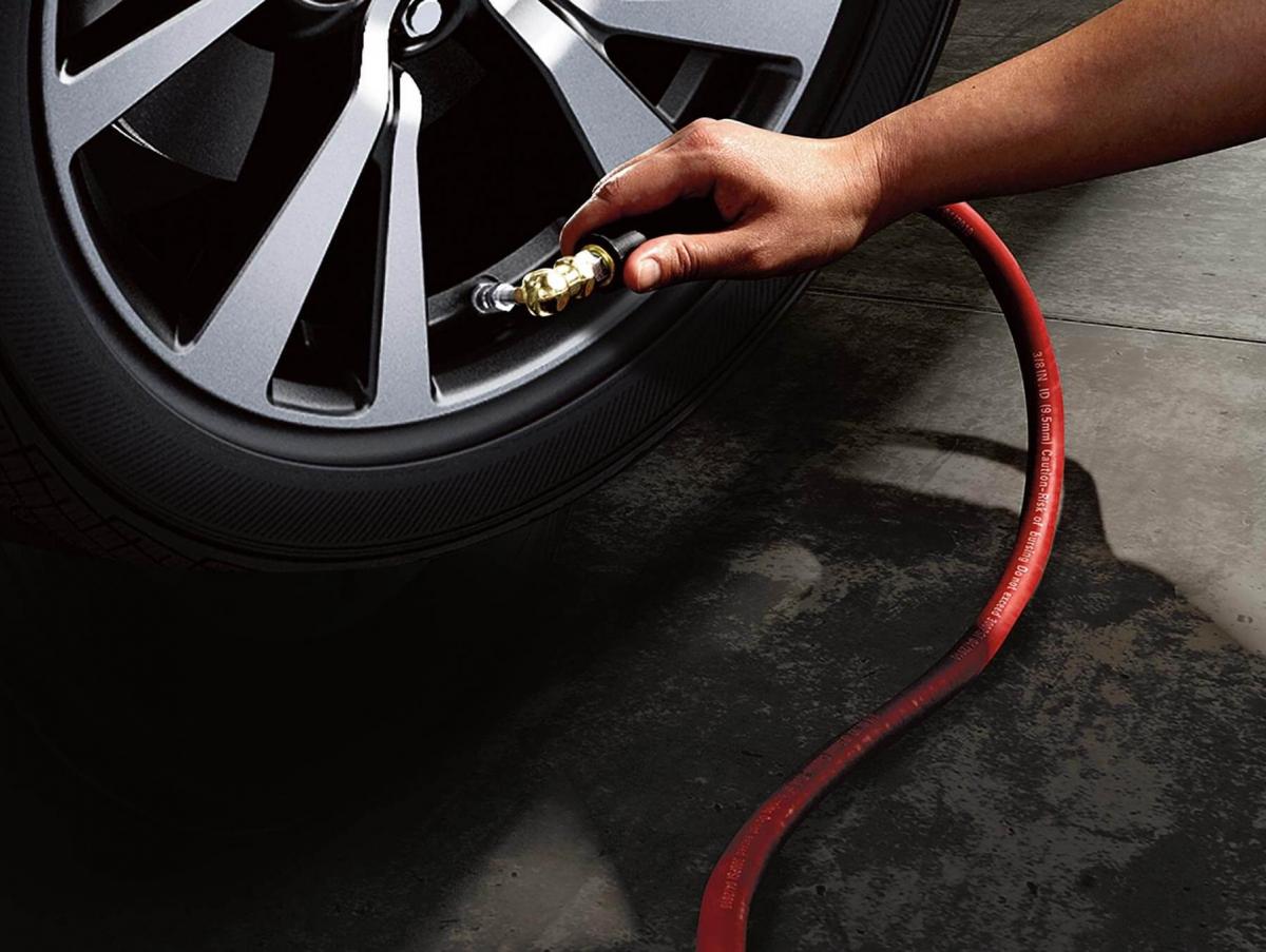 Nissan Service technician filling up tire