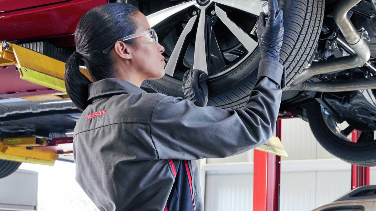 Nissan Technician Filling up a Tire
