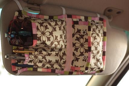 Get a Car Visor Organizer to keep essential items organized and handy.