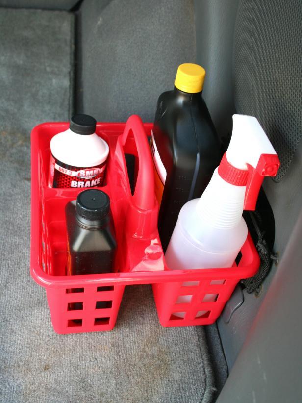 Use a shower caddy to organize car fluids